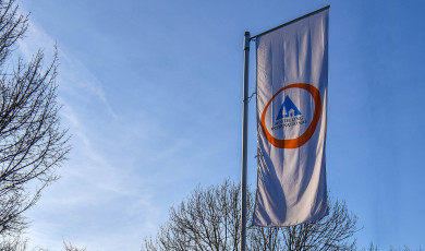 "Flag with ""Hostelling International"" lettering in front of Lörrach Youth Hostel"